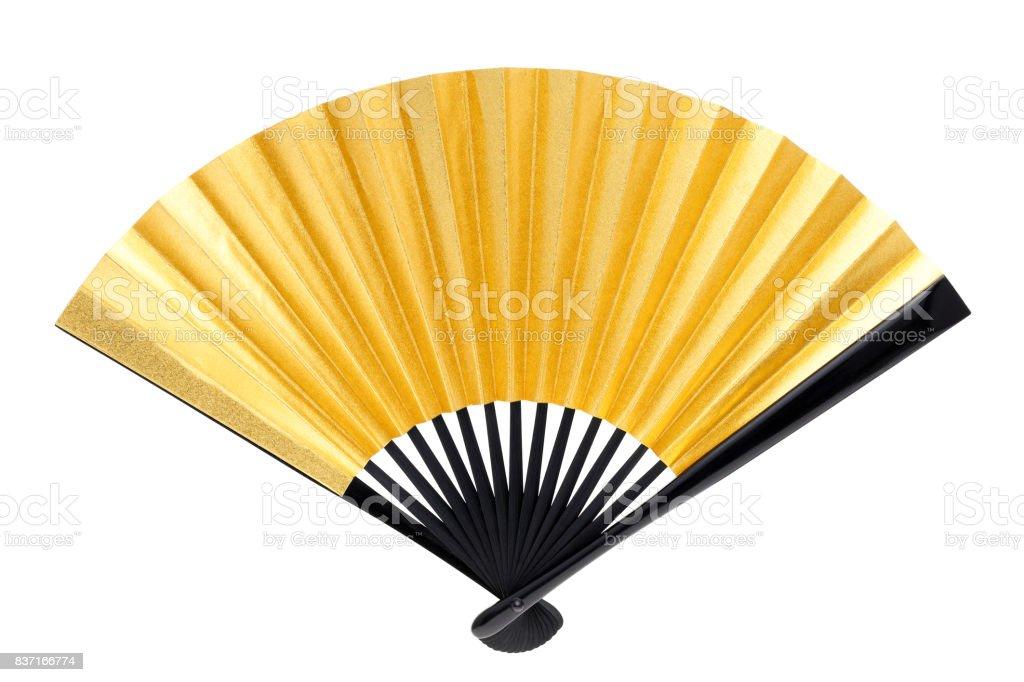 traditional golden folding fan stock photo