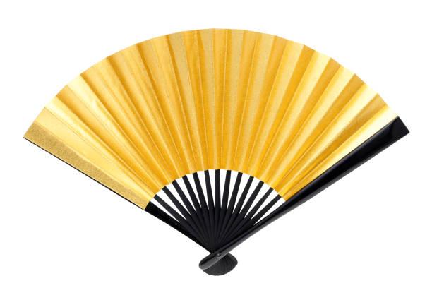 traditionelle goldene faltbaren lüfter - japanischer fächer stock-fotos und bilder