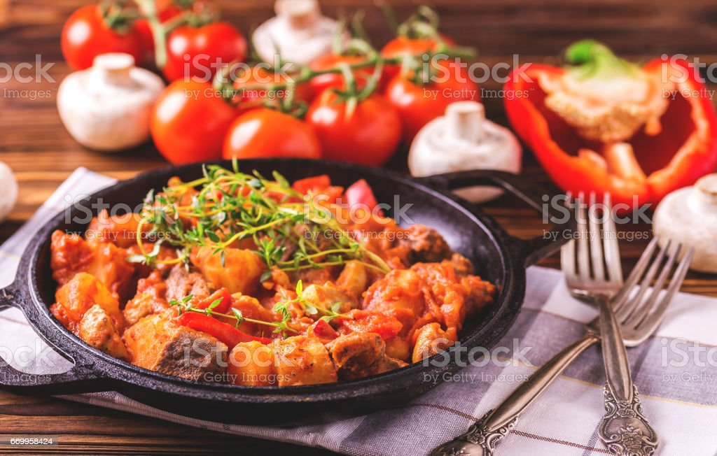 Traditional goulash soup close-up on  wooden table. Ingredients. stock photo