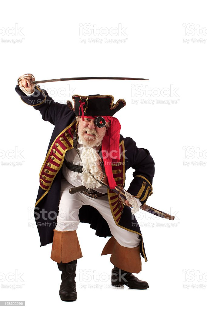 Traditional gray bearded pirate captain lunging forward with raised sword stock photo