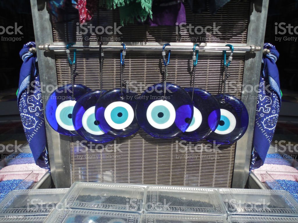 traditional greek blue evil eyes from glass at a souvenir shop - symbol of protection - decorative elements royalty-free stock photo