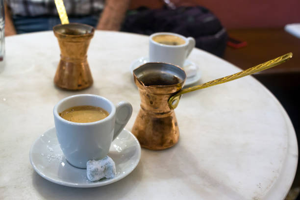 Traditional greek coffee served with brass pot and sweet loukoumi. Taken in Athens stock photo