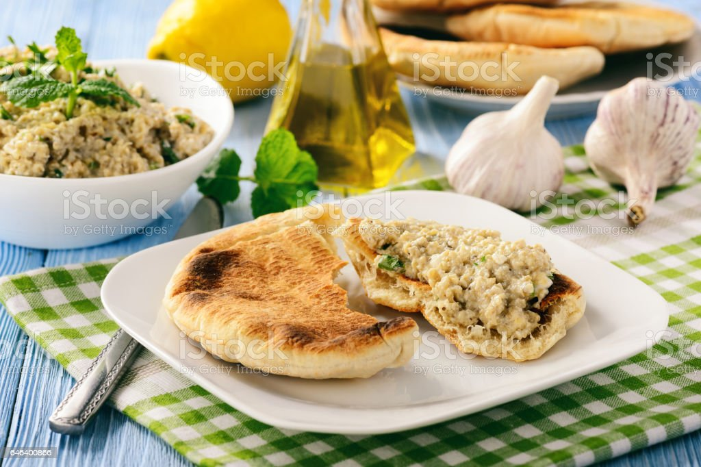 Traditional greek eggplant spread (dip) with pita bread. stock photo