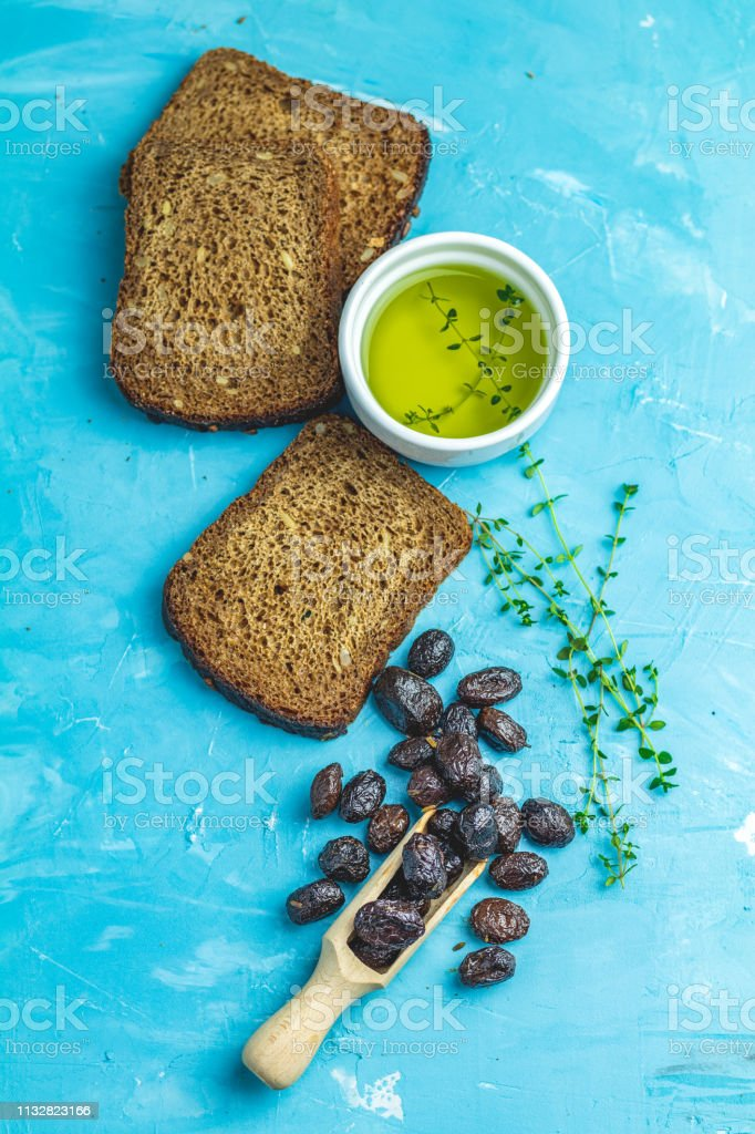 Traditional greek italian appetizer dried black olives stock photo