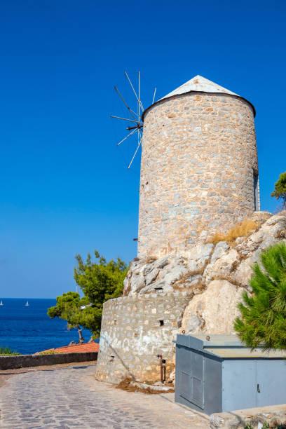 Traditional Greek Mill on Hydra island, Greece stock photo