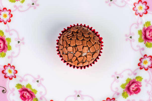 Traditional handmade Brazilian chocolate candy called brigadeiro. Top view. Traditional handmade Brazilian chocolate candy called brigadeiro. Top view. estudio stock pictures, royalty-free photos & images
