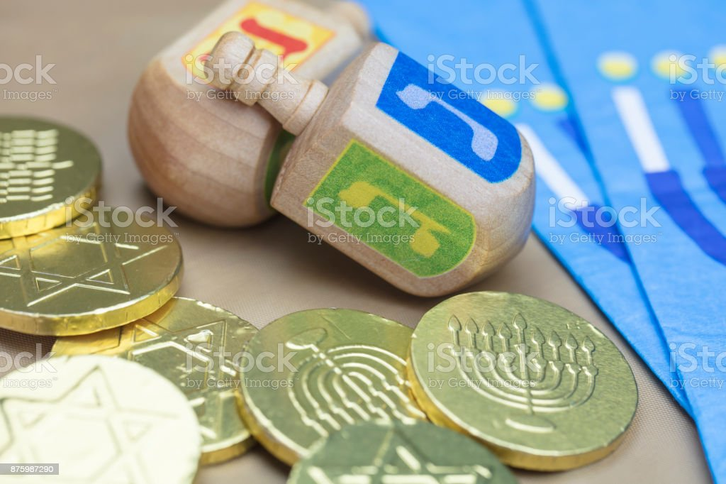 Traditional Hanukkah Dreidels, Napkins and Chocolate Gelt Coins stock photo