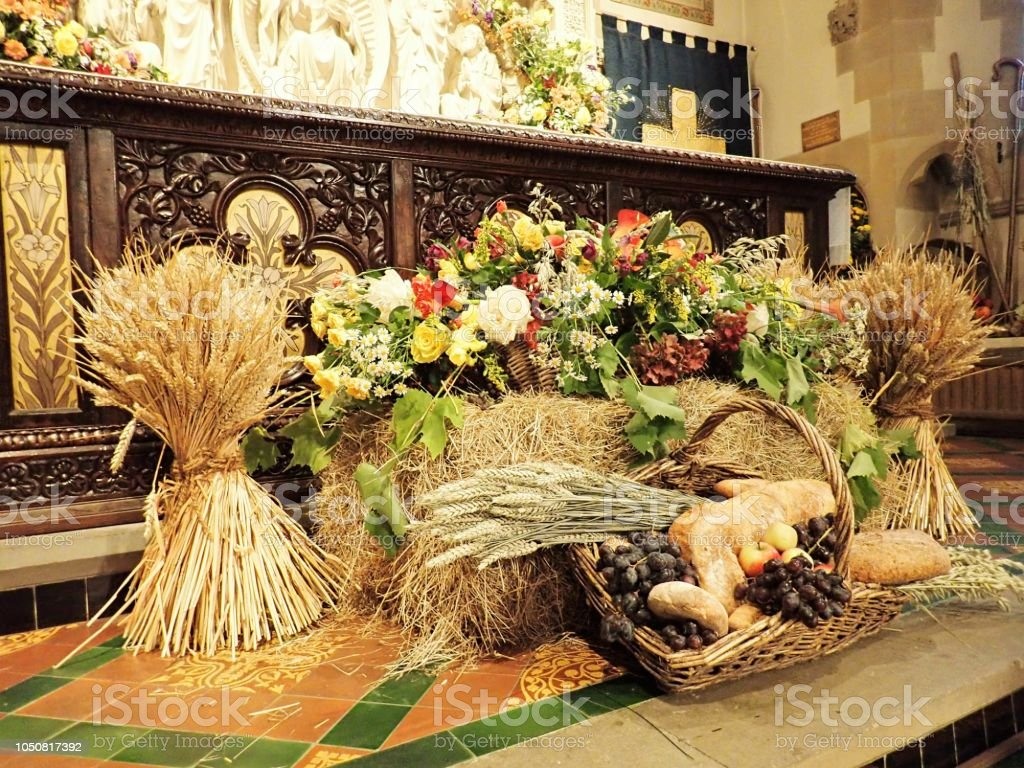 Traditional harvest festival altar in English Anglican church stock photo