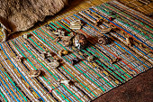 istock Traditional Healer known as a Sangoma or witch-doctor performing a spiritual reading with bones and shells 1283678273