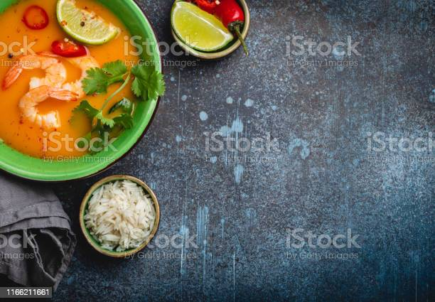Traditional healthy thai soup tom yum with shrimps lime coriander in picture id1166211661?b=1&k=6&m=1166211661&s=612x612&h=sfbj0e lyg6uku0mh2kaipz0fi1fuz9az00e7k4hnuo=