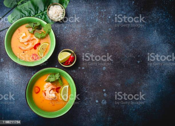 Traditional healthy thai soup tom yum with shrimps lime coriander in picture id1166211734?b=1&k=6&m=1166211734&s=612x612&h=qhlx335h5wt0 suspgs9hotaheh3z7y8s4j7r8q6a0i=