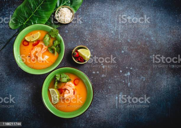 Traditional healthy thai soup tom yum with shrimps lime coriander in picture id1166211744?b=1&k=6&m=1166211744&s=612x612&h=unj03v isxl mzmgdzydzij y88nk1s2uql8240pa q=