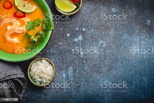 Traditional healthy thai soup tom yum with shrimps lime coriander in picture id1166211769?b=1&k=6&m=1166211769&s=612x612&h=jjp fcfoojwe1lcyyvgwhls3g4ifactkdtunsmfluew=