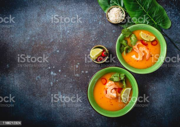 Traditional healthy thai soup tom yum with shrimps lime coriander in picture id1166212324?b=1&k=6&m=1166212324&s=612x612&h=erh9nq3h2r2d30u1jn5kydvhihak0nttaaur70  x34=