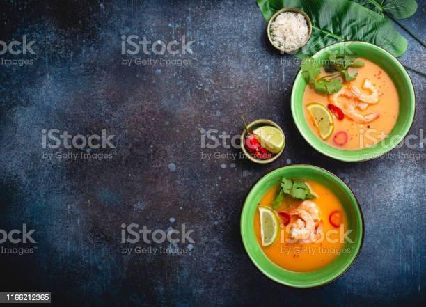 Traditional healthy thai soup tom yum with shrimps lime coriander in picture id1166212365?b=1&k=6&m=1166212365&s=612x612&h=qju6u2e89obl2szglnykh6x urr2m9cjecpi0ql8ewm=
