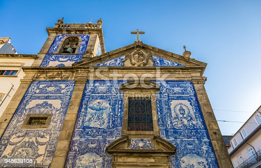 937530990 istock photo Traditional historic facade in Porto decorated with blue hand painted tin-glazed tiles, Oporto, Portugal 948639108