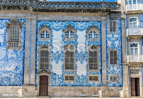 istock Traditional historic facade in Porto decorated with blue hand painted tin-glazed tiles, Oporto, Portugal 998038734