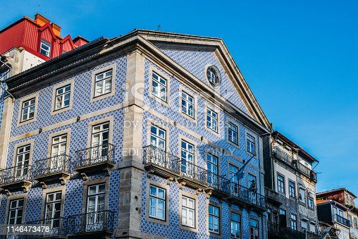 937530990 istock photo Traditional historic facade in Porto decorated with blue tiles, Portugal 1146473478