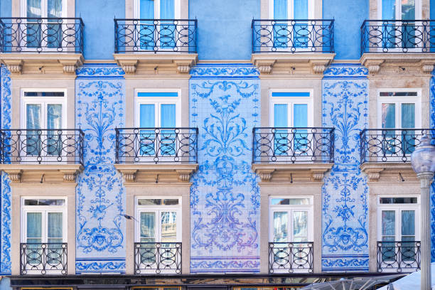 traditional historic facade in porto decorated with blue tiles, portugal - portugal stock photos and pictures