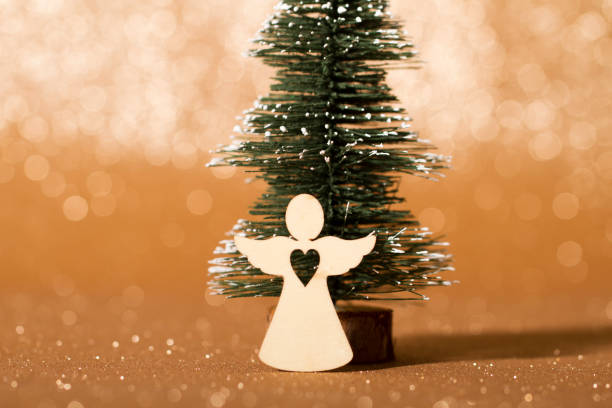 Traditional holiday Christmas decorations, beautiful Christmas trees and trinkets Traditional holiday Christmas decorations, some gifts and objects. angelic stock pictures, royalty-free photos & images