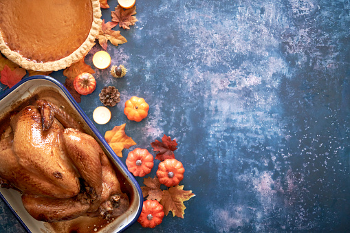 Traditional Holiday Stuffed Turkey on Rustic Background