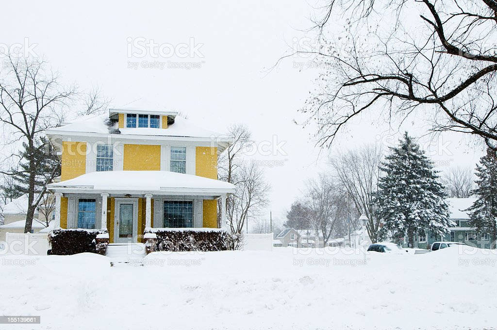 Traditional Home in a Snow Storm royalty-free stock photo