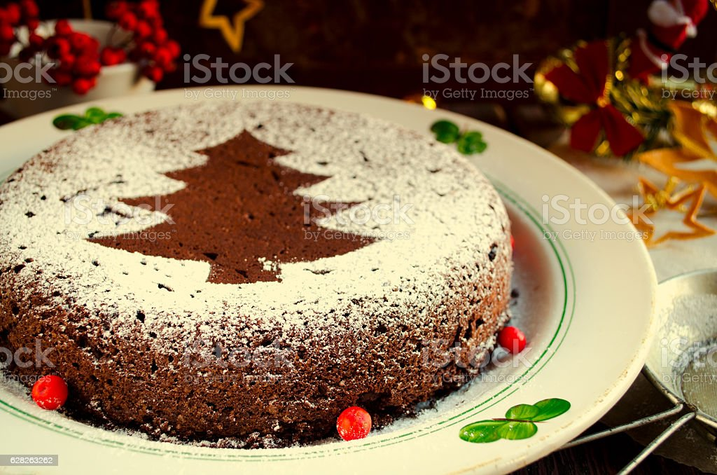 Traditional Homemade Chocolate Christmas Cake Sprinkled With Sugar