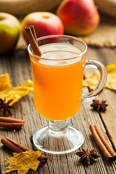 Traditional homemade hot apple cider thanksgiving winter celebration beverage with stock photo