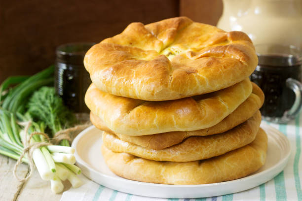 traditional homemade romanian and moldovan pies - placinta, served with wine. rustic style. - moldova stock pictures, royalty-free photos & images