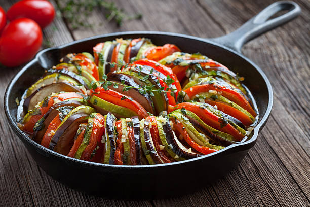 Traditional homemade vegetable ratatouille baked in cast iron frying pan stock photo