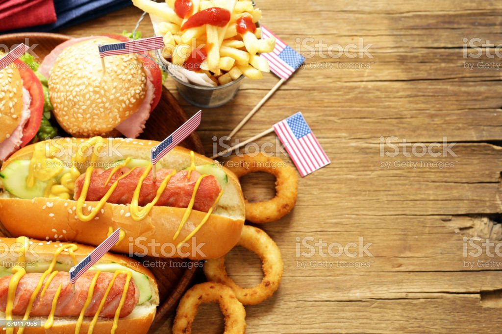 Traditional hot dog, french fries and onion rings food stock photo
