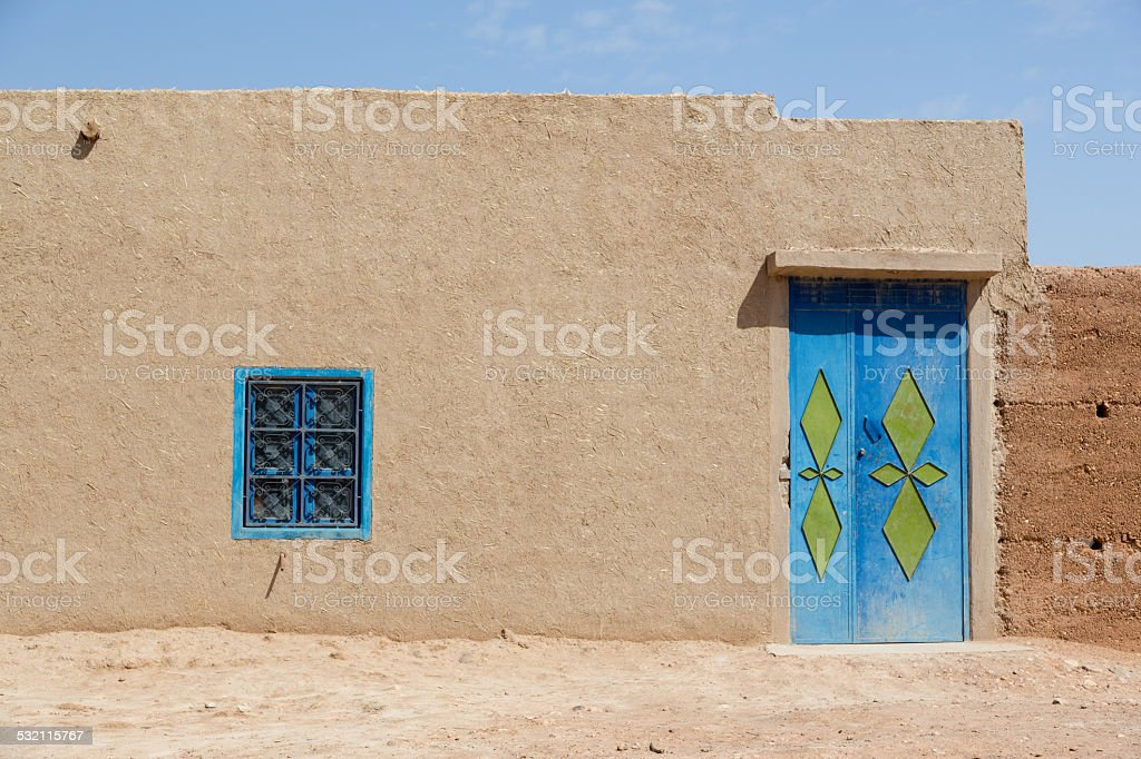 Traditional house and door in the desert of Morocco. stock photo