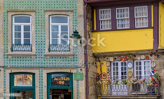 Porto, Portugal - May 29, 2018: Facades of traditional houses decorated with ornate Portuguese azulejo tiles in the famous Ribeira neighborhood