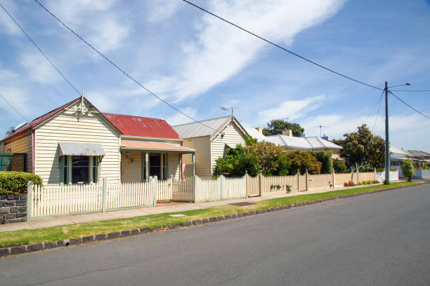 Traditional House with a painted picket fence - Melbourne stock photo