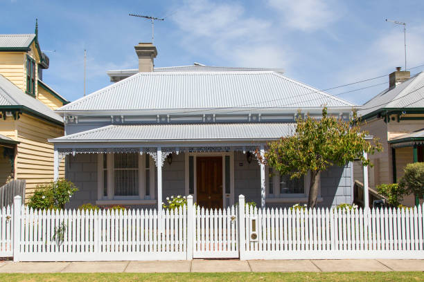Traditional House with a white picket fence - Melbourne Williamstown, Australia: March 07, 2019: Traditionally built bungalow in the 20th century Australian style in Williamstown with a porch, ornate verandah, garden gate and white picket fence. australian culture stock pictures, royalty-free photos & images