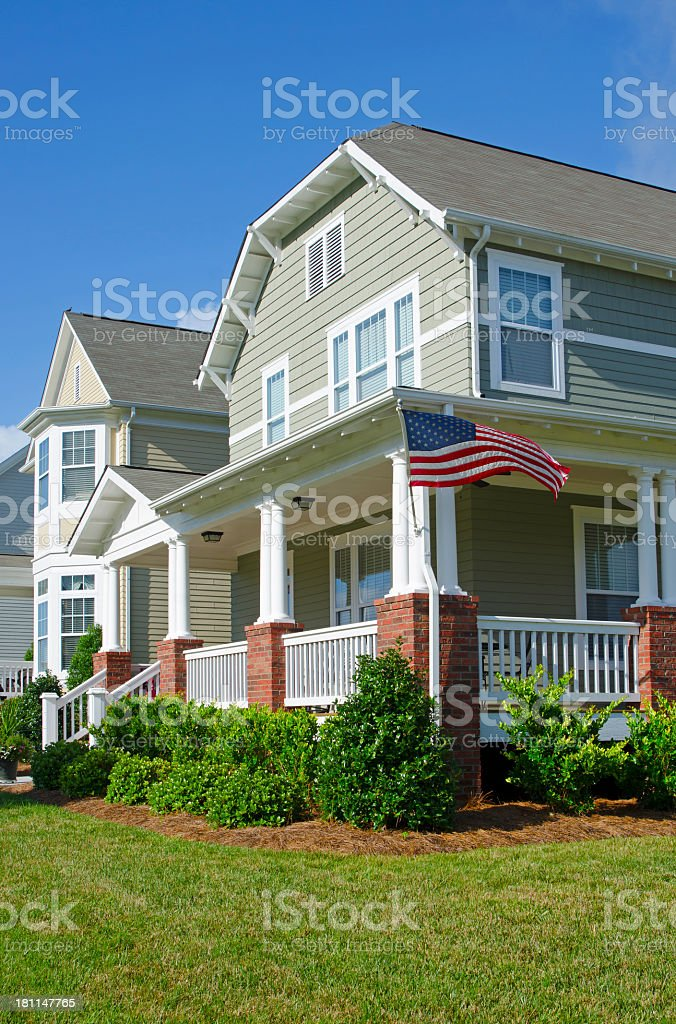 traditional house with American flag royalty-free stock photo