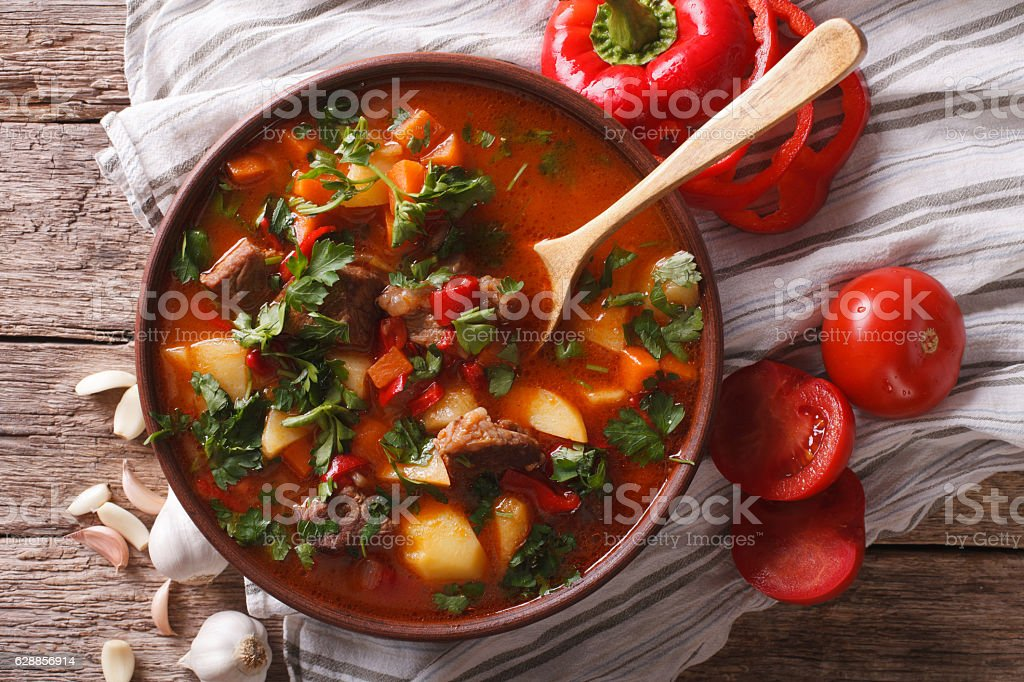 Traditional Hungarian goulash soup bogracs close-up in a bowl stock photo