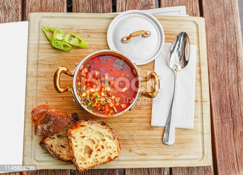 Traditional Hungarian goulash soup with a beautiful serving in the national restaurant. The concept of local cuisine in Budapest