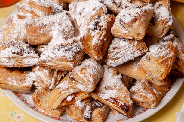 Traditional hungarian homemade lard puff pastry wraps with jam stock photo