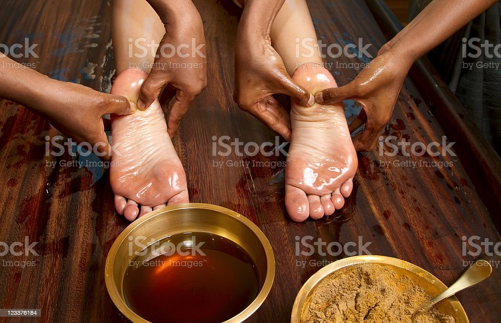 traditional indian ayurvedic oil foot massage royalty-free stock photo