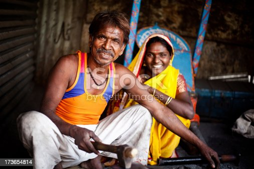 istock Traditional Indian Blacksmith at work with his Daughter 173654814