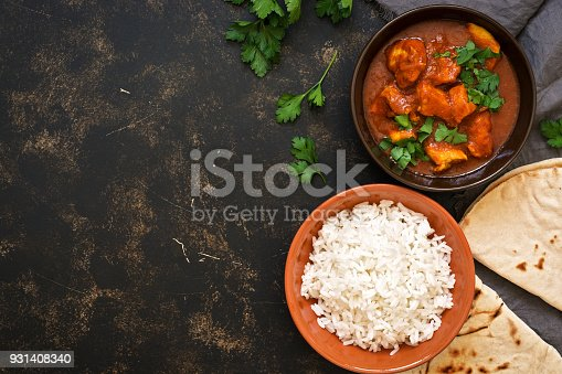 istock Traditional Indian dish chicken Tikka masala. Top view, copy space. 931408340