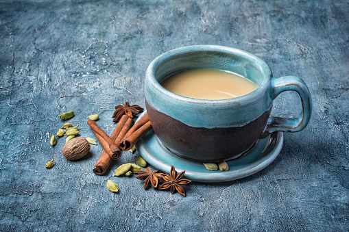 Traditional indian drink masala chai tea with milk and spices