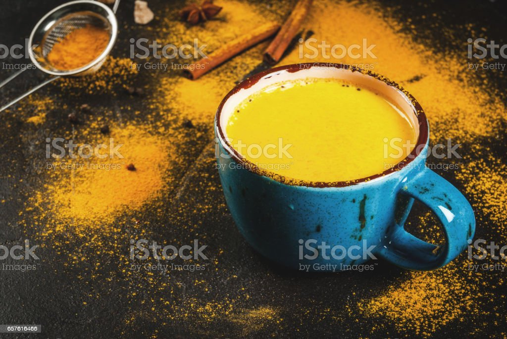 Traditional Indian drink turmeric milk stock photo