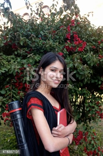 istock Traditional Indian girl going to college. 478357131