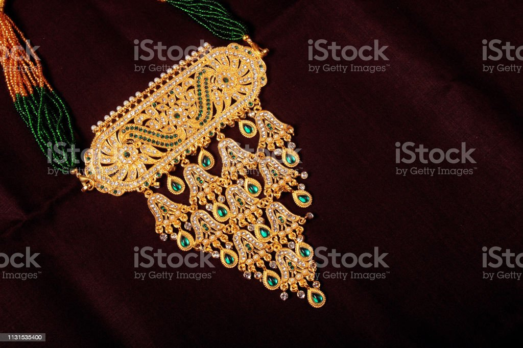 Traditional Indian Gold Jewelery Necklace Wear In Neck Stock Photo