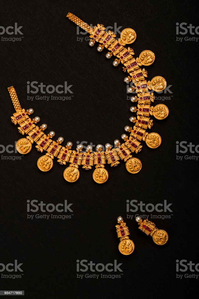Traditional Indian Gold Necklace With Earrings stock photo