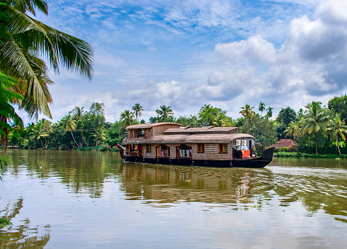 Alleppey, India - October 18, 2014: Traditional Indian houseboat near Alleppey on Kerala backwaters, India