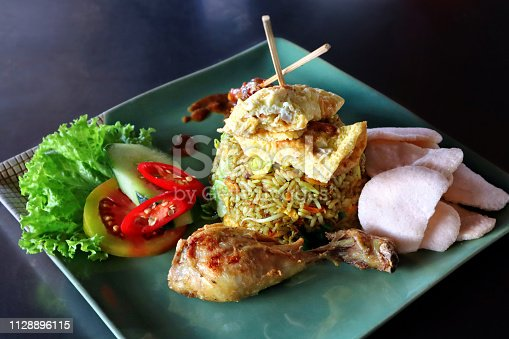 Traditional Indonesian Nasi Goreng fried rice dish with egg and chicken