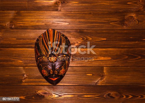 Traditional Indonesian mask, Baliness, on wooden background